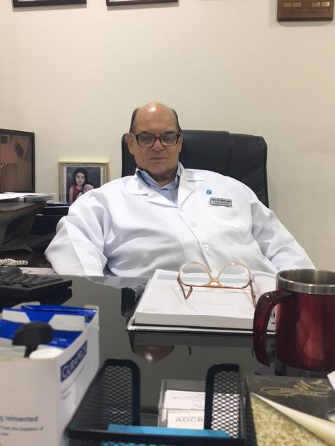 Dr Asmat Lone at his office