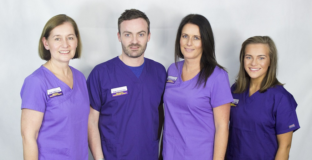 Clare, Thomas, Julieann and Alice wearing scrubs