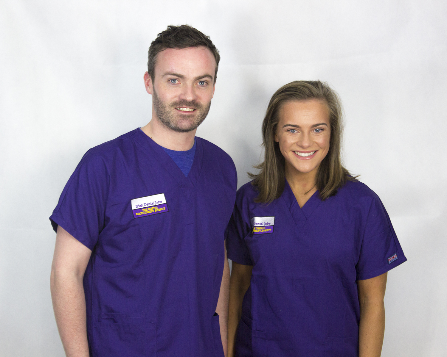 Thomas and Alice wearing scrubs